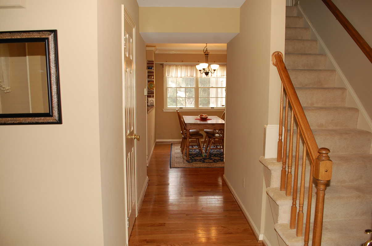 Foyer after staging the welcome home interior design for Interior design solutions