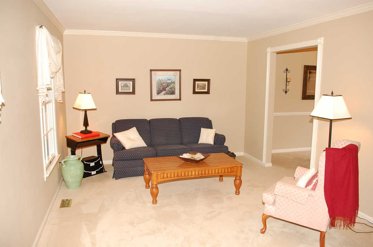 Living room after staging the welcome home interior for Interior design solutions