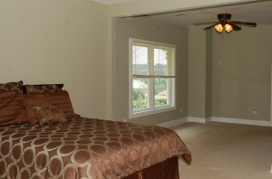 Staged master bedroom in a vacant home