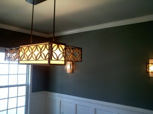Modern lighting in a traditional dining room