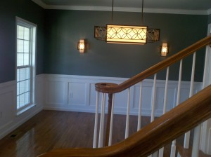 We combined traditional trim work with modern colors and lighting
