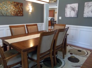 wall sconces and modern chandelier in traditional dining room