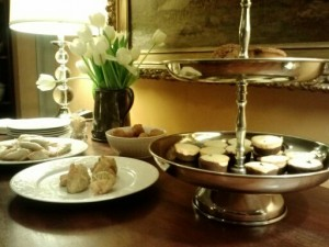 An elegant and simple buffet with old silver and tulips